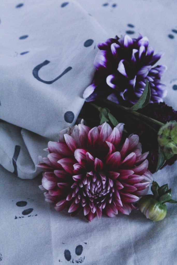blockprinted linens and pink + purple flowers