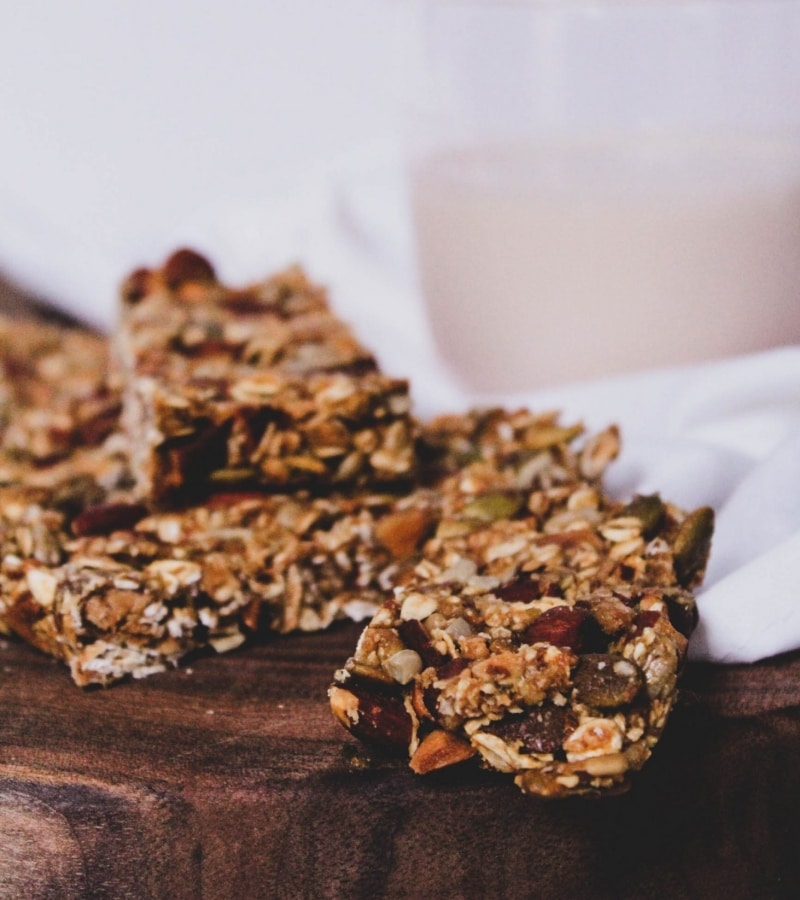 close up of DIY granola bars with almond milk