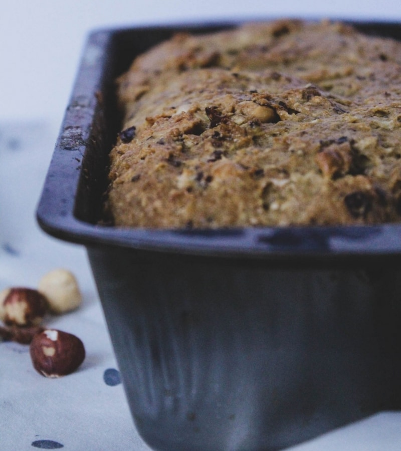 Parsnip and Meyer Lemon Loaf Cake with Toasted Hazelnuts + Dates in pan