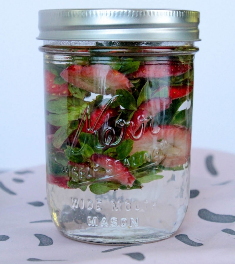 strawberry top infused water in glass jar