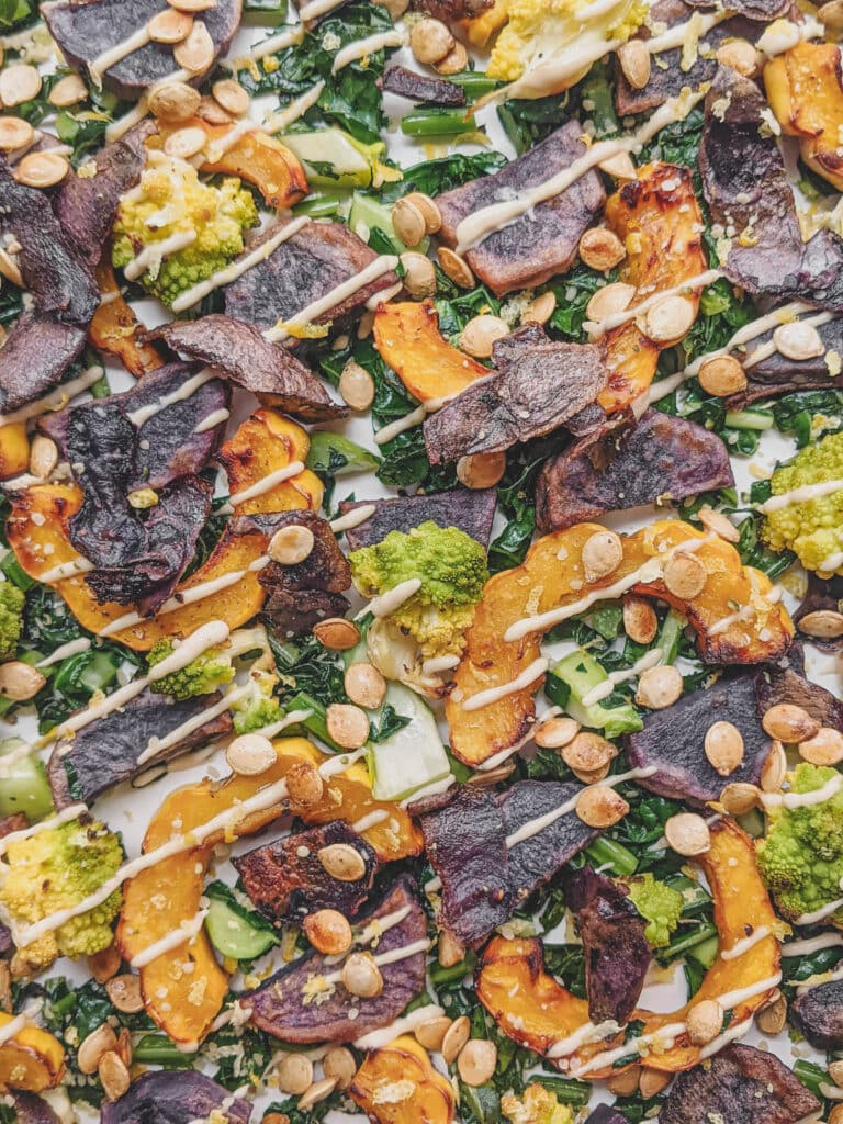 use it all fall salad finished with squash seeds and tahini dressing